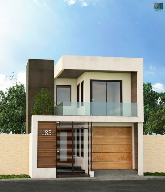 fachada con suelo en bloque de hormigon y puerta de madera