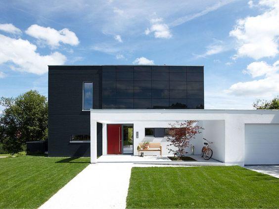 fachada de casa con cubierta oscura (3)