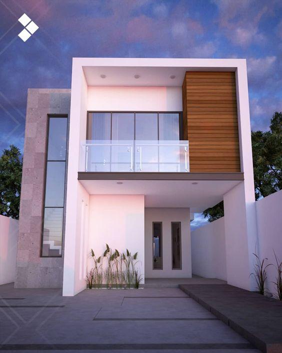 fachada de casa pequena con balcon pequeno en el segundo piso