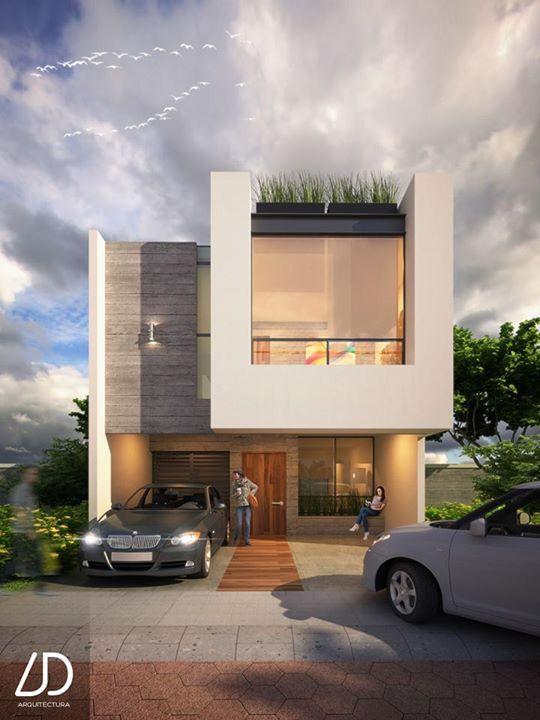 fachada de casa pequena con detalle de volumen en la entrada