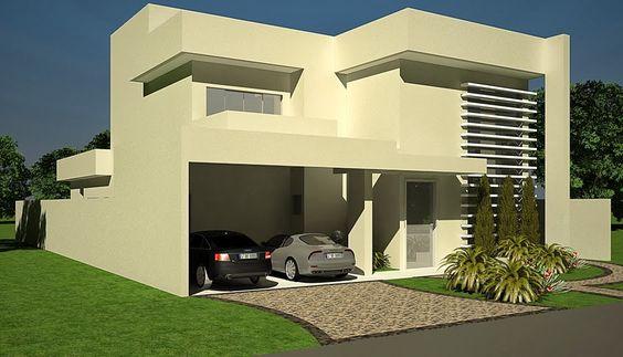 fachada de casa pequena con detalle en pintura verde (2)