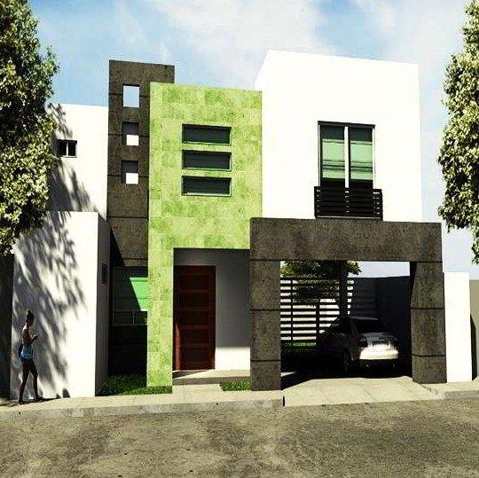 fachada de casa pequena con detalle en pintura verde
