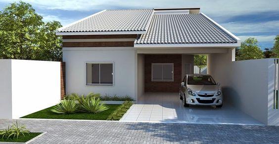 fachada de casa pequena con garage abierto