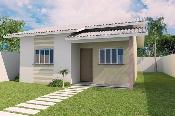 fachada de casa pequena con pintura verde clara y estructura en pintura blanca