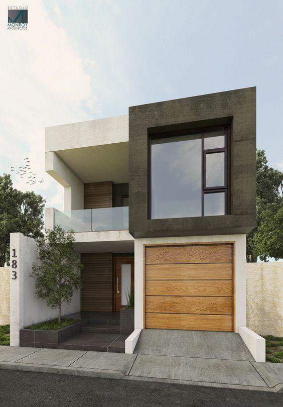 fachada de casa pequena con ventana reflejada