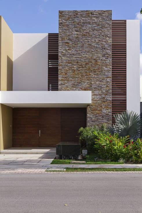 fachada de casas sencillas en columnas de piedra (3)