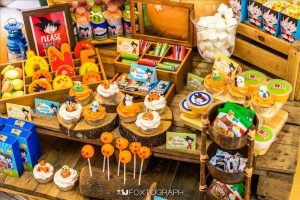 como decorar una mea de postres para fiesta infantil de goku (7)