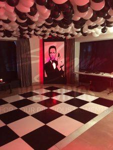 Fiesta de cumpleaños para hombre con tema de James Bond