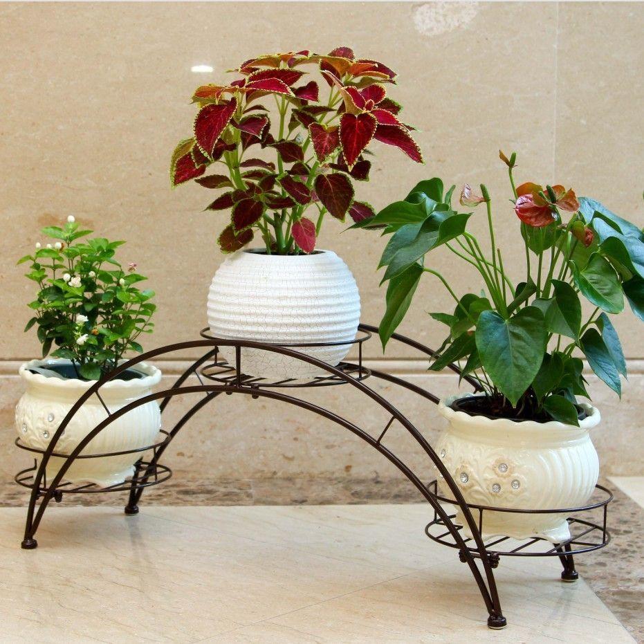 Macetas y adornos para jard n de hierro reciclados for Macetas para jardines pequenos