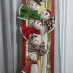adornos de fieltro para navidad en marcos de madera