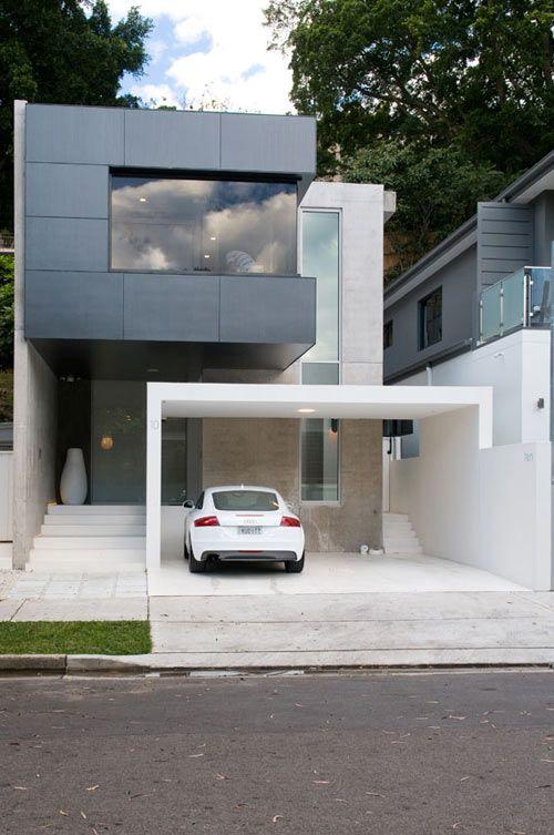 Diseños de casas de dos pisos con cochera abierta