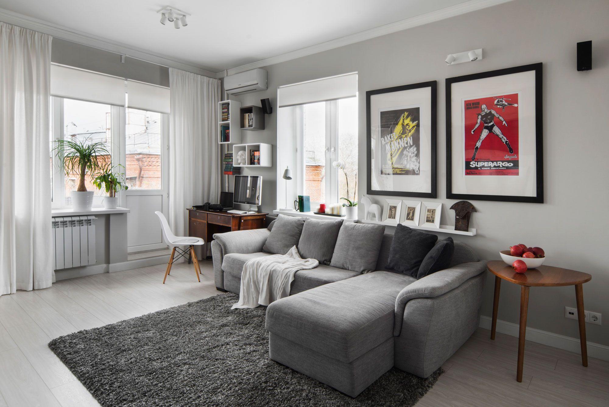 Usar sillones en forma de L para que tu sala se vea mas grande