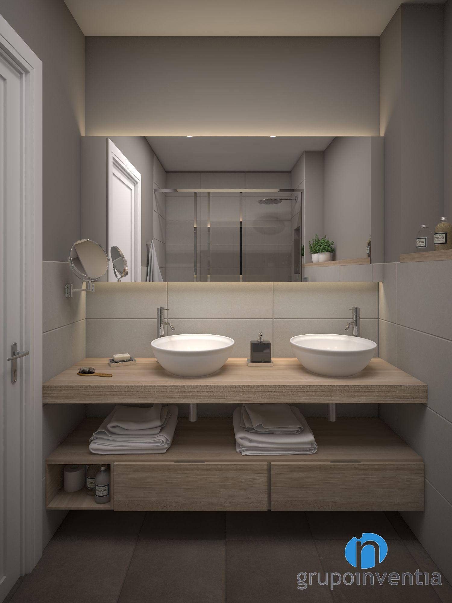 Baños con dos lavabos con acabado en madera
