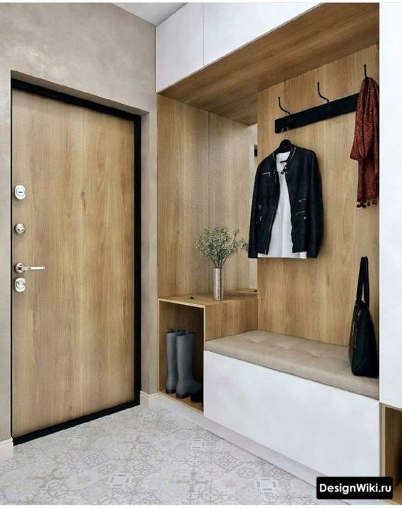 El color blanco y el acabado en madera son ideales para tu hall