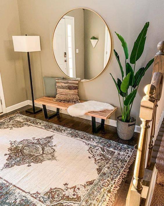 Utiliza espejos grandes para tu hall
