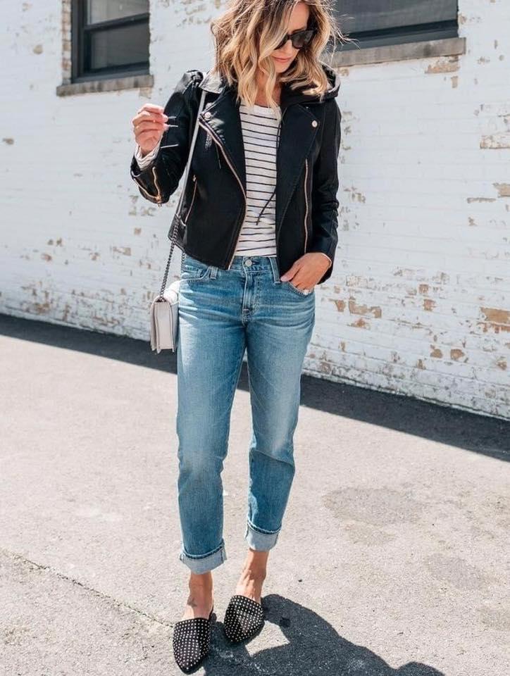 Look con chaqueta negra y jeans