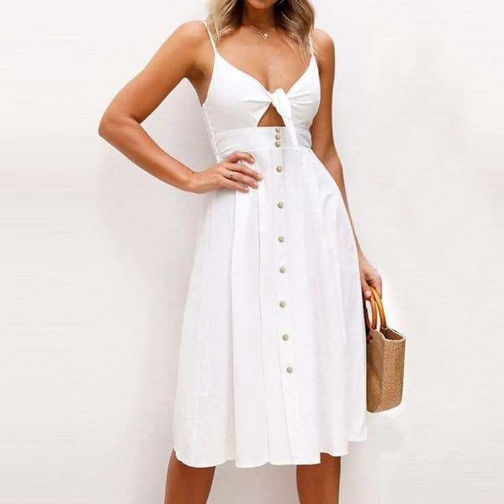 Vestido blanco con apertura para lucir espectacular