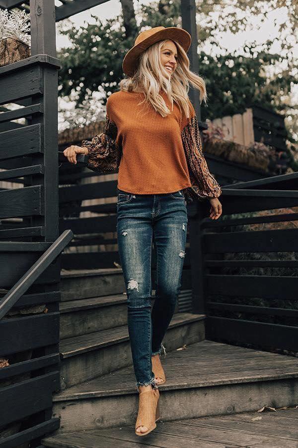 Blusa con mangas decoradas para el otoño