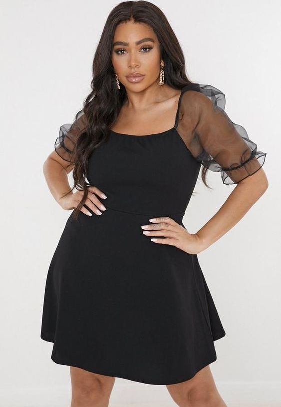 Looks con vestido negro para gorditas