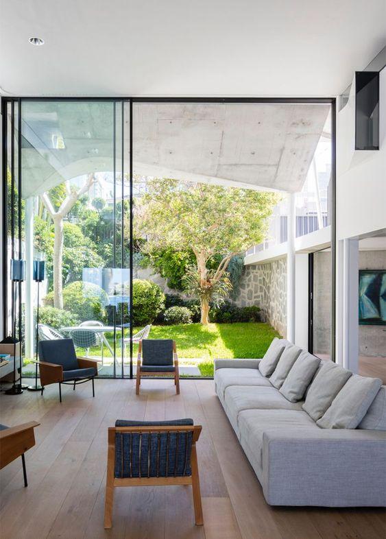 Tendencia en salas con jardín lateral