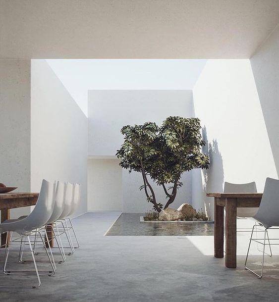 Ejemplos de patios interiores para casas introspectivas