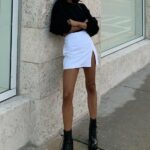 Looks con botas altas y mini faldas